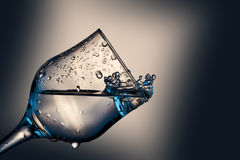 Glass with water splash Royalty Free Stock Images