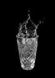 Glass of water and splashes Royalty Free Stock Photo
