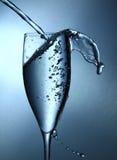 Glass of water splashes Stock Photo