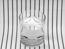 Glass of water. Symmetry, refraction. Royalty Free Stock Photography
