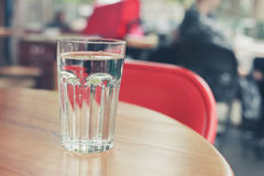 Glass of water on table outside Stock Image