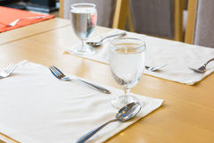 Glass of water on table setting for dining Royalty Free Stock Photos