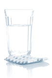Glass with water and tablets, pills Royalty Free Stock Images