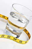 Glass of water with tape measure Stock Photos