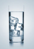 Glass of water with three ice cubes royalty free stock image