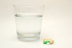 Glass Of Water and Vitamins Stock Photography