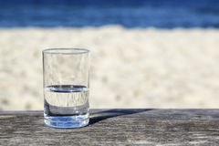 Glass of water which is half-full stock photos
