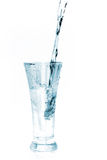 Glass of water on white Royalty Free Stock Photography