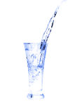 Glass of water on white Royalty Free Stock Image
