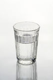 Glass of water. A glass of water on a white background Royalty Free Stock Image