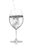 Glass with water  on a white background. Royalty Free Stock Image