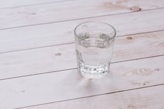 Glass of water on wood table background.  Stock Photos