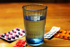 A glass of water. In a wooden table Royalty Free Stock Image