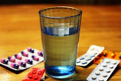 A glass of water. In a wooden table Royalty Free Stock Images