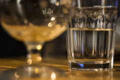 Glass of water on wooden table at Christmas Eve royalty free stock photography