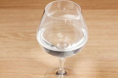 Glass water on wooden table,. Close up Stock Photo