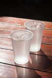 Glass of water on wooden table Stock Photo