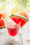 Glass of watermelon juice on rustic wooden table over sunny nature background Stock Photography