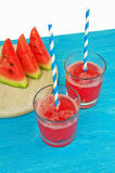 Glass of watermelon smoothie on a wooden table. Selective focus Royalty Free Stock Photography