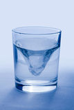 Glass of wather. I with Clipping Path on blue background Stock Photography