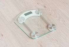 Glass weight scale. Standing on a wooden floor Stock Photos