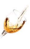 Glass in which the wine is poured. On white background Royalty Free Stock Images