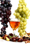 Glass of whine and grapes Stock Photo