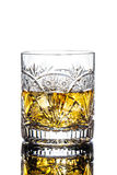 Glass of Whiskey. A crystal glass of whiskey on the rocks  on white background Royalty Free Stock Image