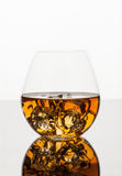 Glass of Whiskey. A glass of whiskey on the rocks  on white background Stock Image