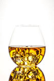 Glass of Whiskey. A glass of whiskey on the rocks  on white background Royalty Free Stock Images