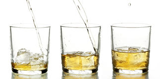 Glass with whiskey. On the white background Stock Photos