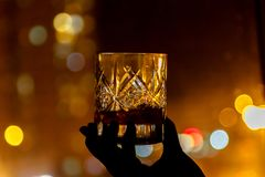 Glass of whiskey against the backdrop of the city. Glass of whiskey against the city royalty free stock images