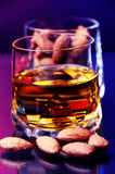 Whiskey and almonds Stock Image
