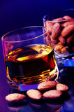 Whiskey and almonds Stock Images