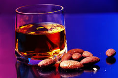 Whiskey and almonds Stock Photo
