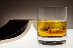 Glass of whiskey and a book - evening relax concept Royalty Free Stock Photography