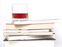 Glass of whiskey on books Stock Photo