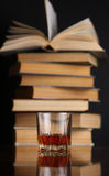 Glass of whiskey and books Stock Image
