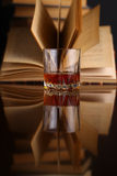 Glass of whiskey and books Royalty Free Stock Photography