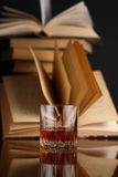 Glass of whiskey and books Royalty Free Stock Images