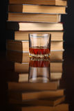 Glass of whiskey and books Stock Photo