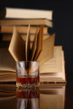 Glass of whiskey and books Stock Photography