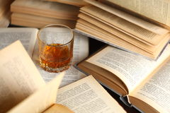 Glass of whiskey on books Royalty Free Stock Image