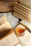 Glass of whiskey on books Royalty Free Stock Photos