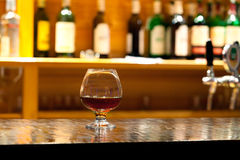 Glass from whiskey and a bottle Stock Image