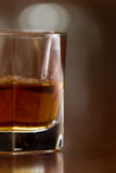Glass of whiskey. Bourbon whiskey served neat on a out of focus busy bar Royalty Free Stock Image