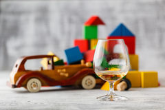 Glass of whiskey and brocken the car. concept to quit drinking Royalty Free Stock Image