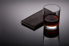 Glass of whiskey and a business card holder Royalty Free Stock Image