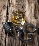 Glass of whiskey and car keys Stock Photo