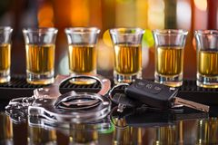 Glass of whiskey and car keys Royalty Free Stock Photography